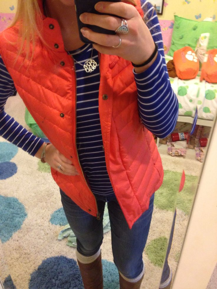 Preppy southern style. Coral Vest, striped shirt, monogram necklace, boots.