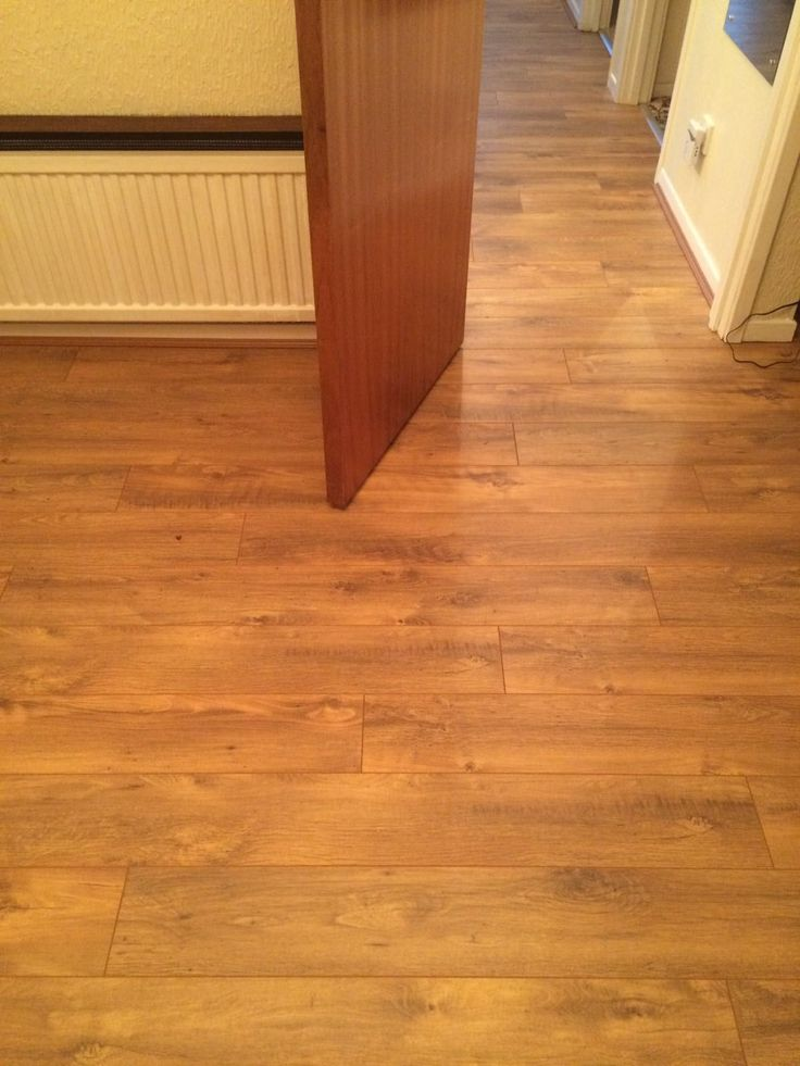 A striking laminate installed in living room through to hallway. Real WoodHallwaysCarpetsRugsMud  ...