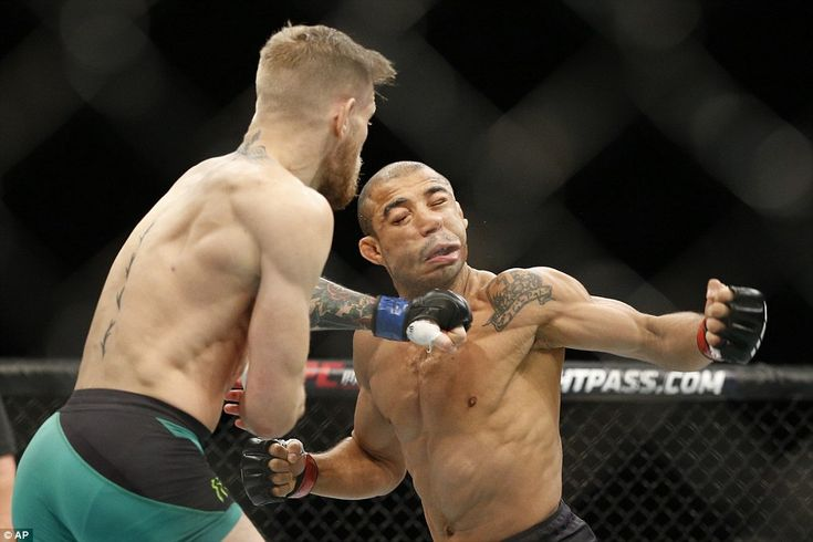 Jose Aldo's face contorts as Conor McGregor's savage left hander knocked the Brazilian out...