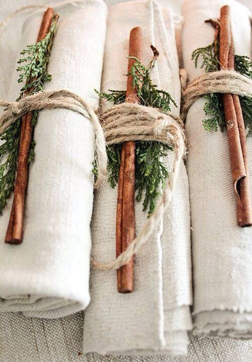 Love these napkins wrapped with pine and cinnamon sticks for the holidays