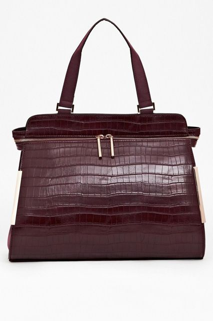 The One Thing To Look For When You're Buying Your Next Tote Bag #refinery29  http://www.refinery29.com/best-tote-bags#slide-13  This bag is all business: The boxy shape, paired with a croc-effect exterior, definitely leave a strong impression. With its clean lines and sophisticated wine-colored finish, no one will be able to tell that inside lies evidence of your day-to-day hoarding habits.