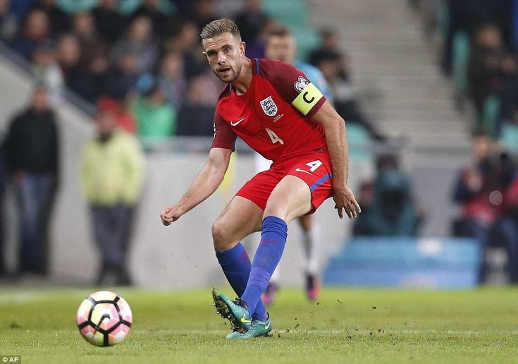 Jordan Henderson plays a pass during a lacklustre first half as he captains his country for the first time in his career