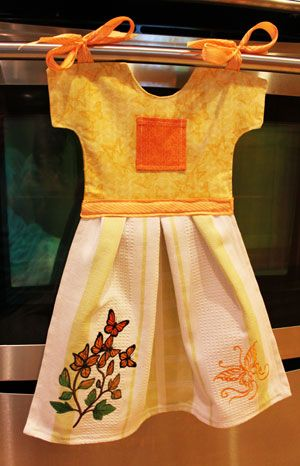 Free project instructions to make a towel and coordinating topper in the shape of a dress.