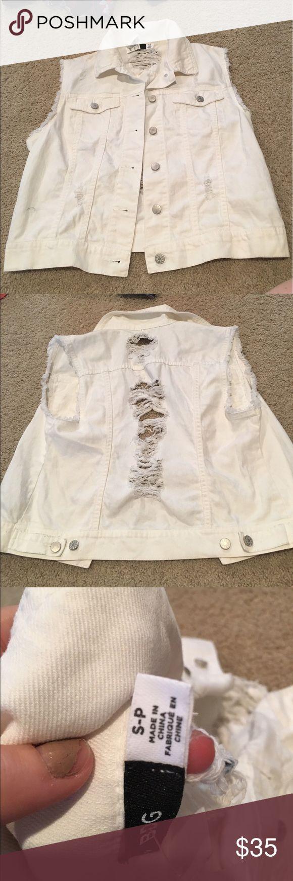 White sleeveless denim jacket never worn White sleeveless denim jacket never worn Urban Outfitters Jackets & Coats Vests