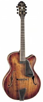 Michael Kelly Nostalgia Heirloom Antique Satin Guitar. Michael Kelly is proud to announce the introduction of its first arched top jazz guitar and it is first-class all the way. Solid flame maple is utilized for the back sides and neck while solid spruce is used for the top. A lightly distressed finish gives it the worn-in look and feel of a guitar discovered in your grandfathers attic. A single suspended mini-humbucker provides a sparkling warm voice that is a perfect match for this very...