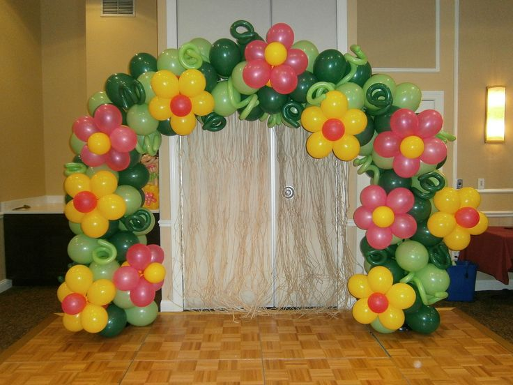 Tropical flower arch for 1st birthday. Bright flowers with