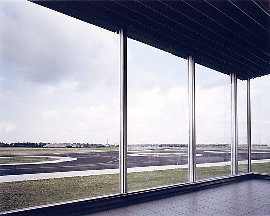 Schipol - Andreas Gursky    There's something about silence of an early morning and an empty runway.