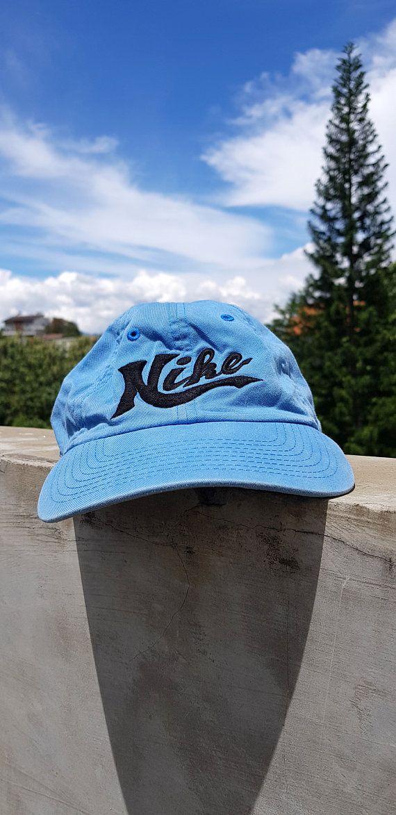 ff2ef62ec21 Vintage 80s 90s Nike Blue Strap Adjustable Size Cap Hat   Dad Hat Nike  Spell Out