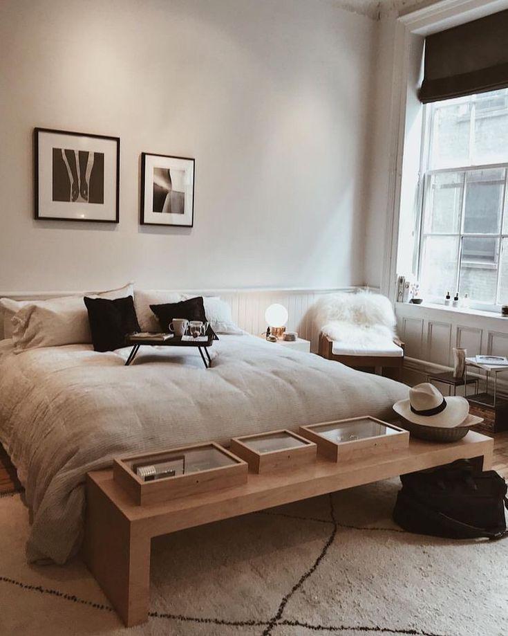 schlafzimmer in weiß schwarz und beige