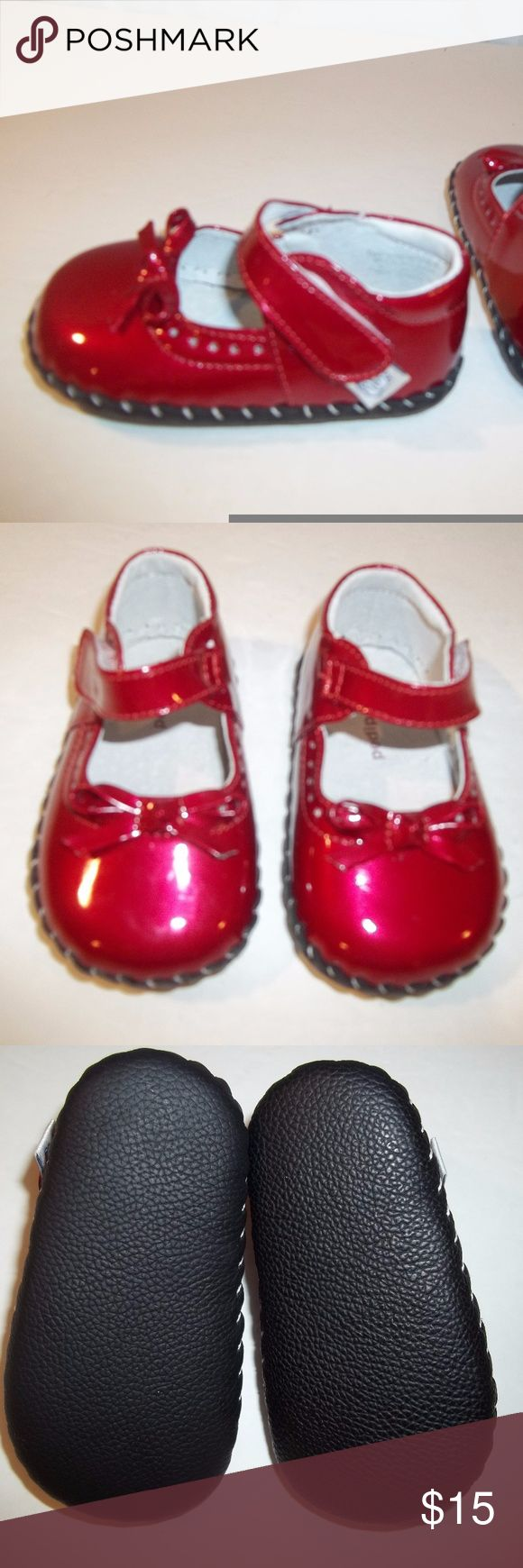 Pediped Baby Shoes Mary Janes Red Size 6-12 Months Baby Girl's Mary Janes Style Shoes  Brand: Pediped  Size: 6-12 Months  Color: Red  Features: Mary Janes style - bow on top  Soft bottom sole  Material: Unknown  Measurements (Outside bottom)  Top to bottom: 5 inches  Side to side (widest spot): 2.5 inches  Condition: Pre-owned in excellent condition.  Appears to have been worn very little.  **The spots on the pictures are from the flash.** pediped Shoes Baby & Walker