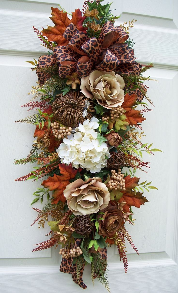 Chocolate brown swag for fall with animal print ribbon. http://www.timelessfloralcreations.com/