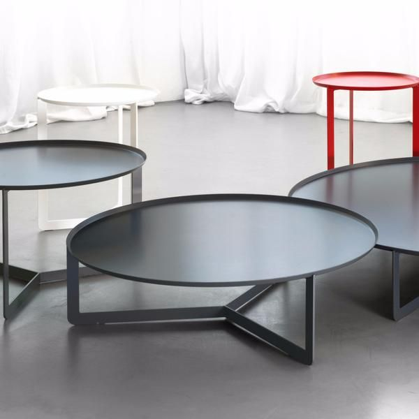The Round 4 coffee table was designed by Enrico Cesana for MEMEDesign. The low table has a tray style top and elegant ultra-slim frame, and comes in 15 colours.