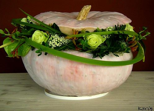 Pumpkins also make beautiful containers for floral arrangements. If you hollow out the pumpkin and coat both the inside and ouside with parafin wax, they will last quite a while, and the wax also subdues the color beautifully.