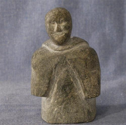 S inuit soapstone carving of woman with backpack