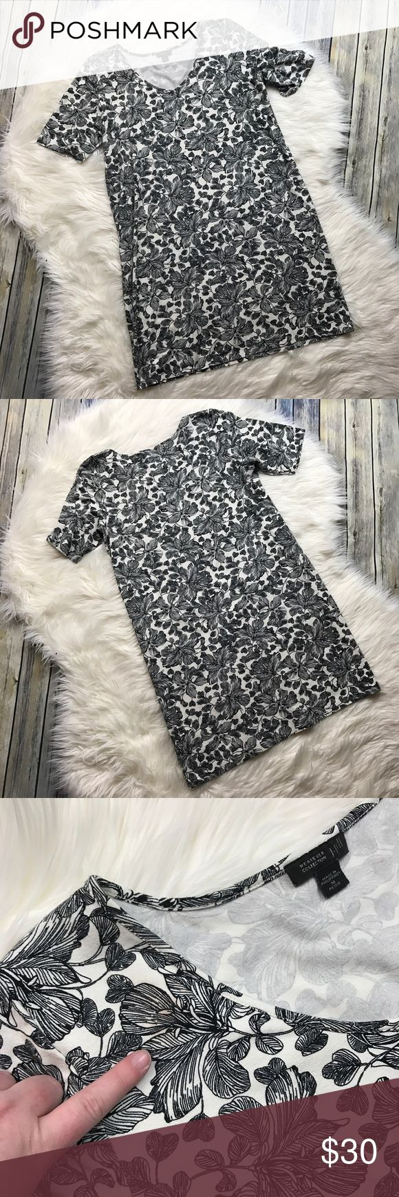 """J. Jill Wearever Collection Floral Knit Dress Adorable black and white floral leaf print jersey knit dress. So soft and comfy. Short sleeve. SMALL FLAW: Please see photos. There is a small stain near the top collar. It is otherwise perfect. The stain is not very noticeable due to the pattern. Petite size medium. 95% rayon, 5% lycra spandex.   Measurements laying flat (without stretching)— Armpit to armpit: 20"""" Length, shoulder to hem: 33"""" J. Jill Dresses"""