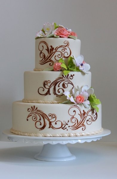 Guave, scrolling and chocolate brown wedding cake