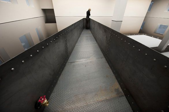 One of my favorites- Richard Wilson's installation' 20:50'  at the Saatchi Gallery i. A room of recycled sump oil.