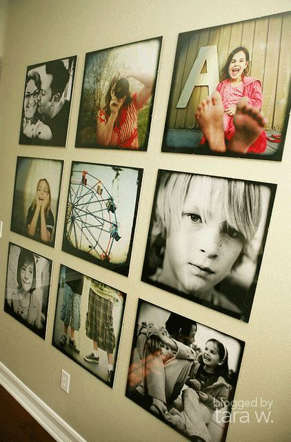 Love it! Copy and past this link in your browser to DIY... http://tarawhitney.com/justbeblogged/2008/06/opam-may-08-photo-wall-in-living-room-after/