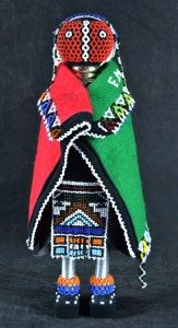 Interiors - Provenance Auction House: Esther Mahlangu (b.1935). Ndebele Doll. Beadwork with metalware and veld signed with intials in beads. 420mm (height).
