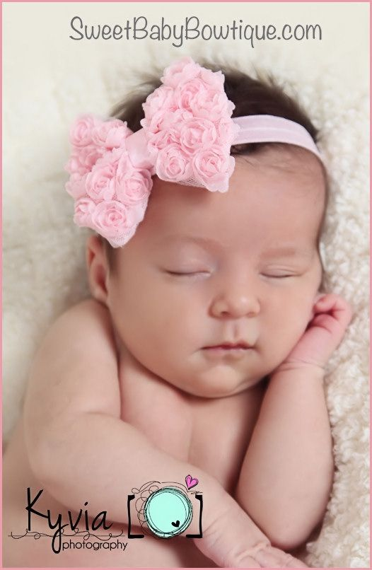 OMG the MOST ADORABLE baby headbands and newborn headbands! www.sweetbabybowtique.com! The Emma Rossette Pink Bow Elastic Headband