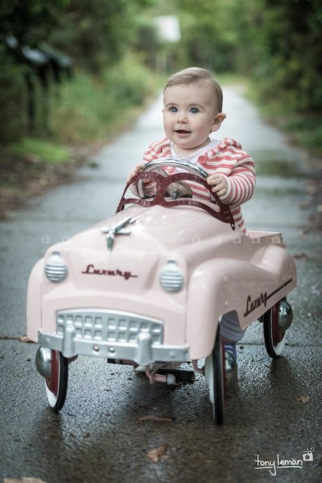 The little pink car - Our cute retro vintage car is available for location shoots and is suitable for children between the ages of 10 months to 7 years.   Photograph sessions available between Brisbane and Sunshine Coast.  Brisbane photographer.