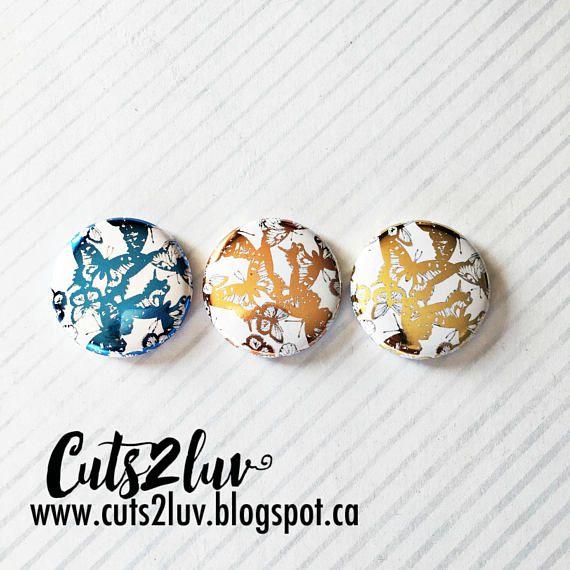 3 Badges 1 Papillons métalliques
