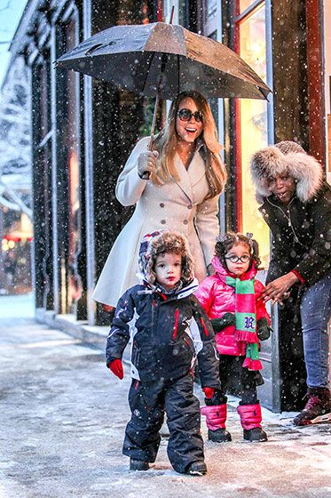 Mariah Carey goes shopping in the snow with twins Moroccan and Monroe in Aspen, Colorado on 20 December.