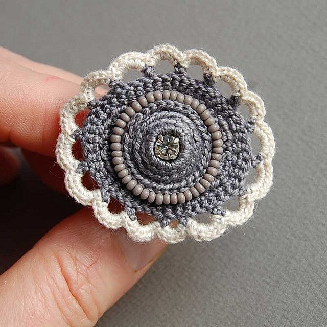 Grey crochet ring. Simply beautiful - would make a cute button to put on a purse or sweater.