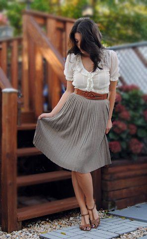 **dreamy sigh** Pleated skirt, lacy blouse, brown belt....