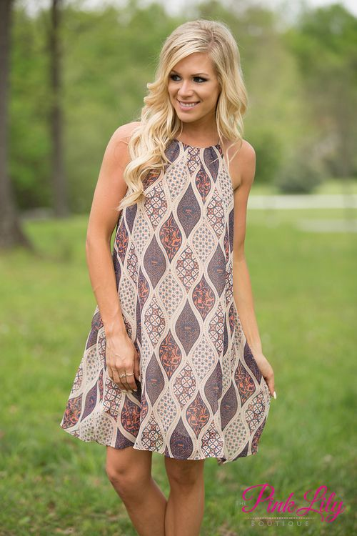 You will look so chic in this boho style dress! We love the print and the gorgeous color combination of navy, faded orange, and light beige! There's even some golden lines throughout the pattern. Just add wedges to rock this halter top dress!