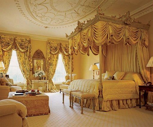 """""""On waking, Tony can look out over the estate's bluegrass fields from his bedroom,"""" Butler says. Neoclassical gilt moldings were added to the ceiling, and the bed is a reproduction of an 18th-century original in Ryan's great house in Ireland. Colefax and Fowler wallcovering."""