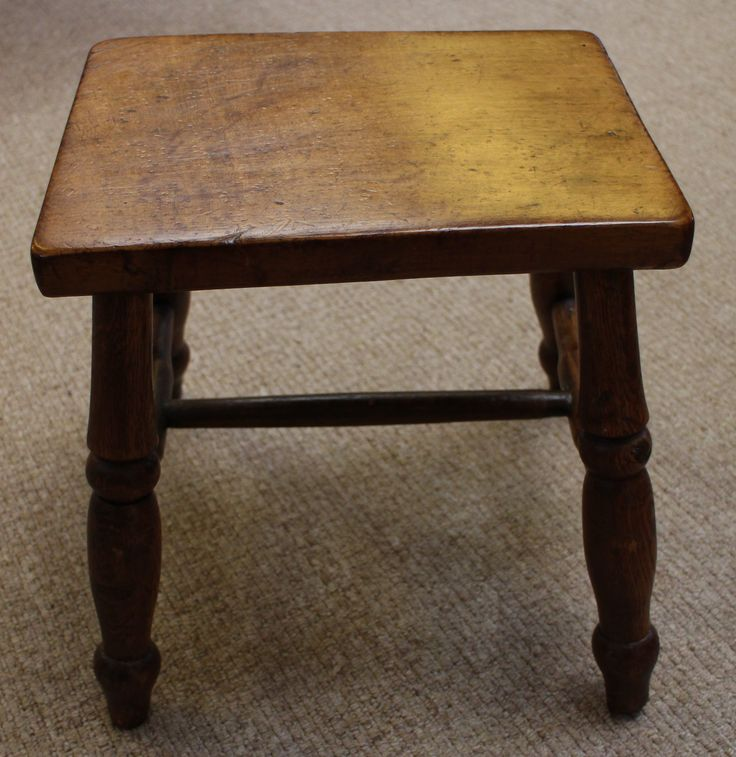 Victorian oak foot stool on four turned legs. Height measures 12.5 inches, length measures 12 inches, width measures 9 inches. Nice patina and very sturdy.