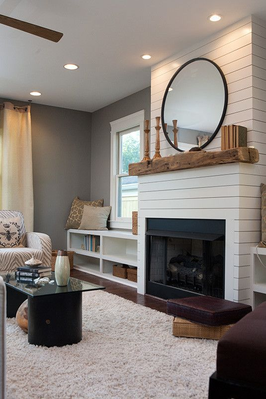 Add benches and windows to either side of the fireplace
