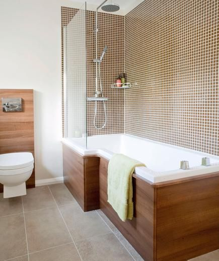 Take a natural approach with caramel mosaic tiles around the shower, large brown tiles on the floor, and walnut wood surrounding the tub and toilet.