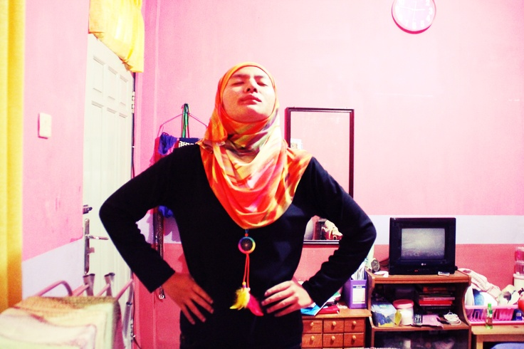 orange hijab and orange dreamcactcher necklace