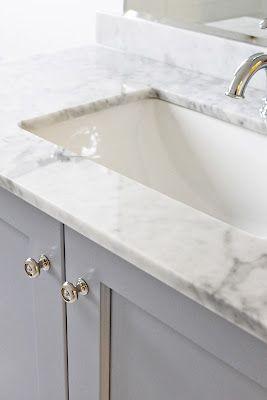 BM Pigeon Gray vanity, Blanco Statuario countertop, rectangle sink, Kholer Fairfax single-control lavatory faucet. AM Dolce Vita
