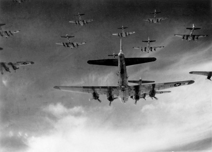 "B-17 ""Flying Fortress"" aircraft flying in formation over Germany, 1945."