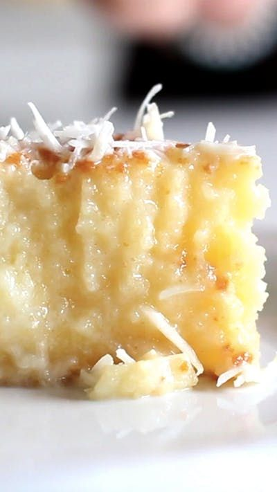 Recipe with video instructions: A cake with a rich coconut base and grated coconut topping. Ingredients: 4 eggs, 1 1/2 cups of sugar, 3 1/2 ounces of room temperature butter, 1.6 cups of coconut milk (26 tablespoons), 1 1/2 cups of flour, 1 cup of whole milk, divided, 1 tablespoon of baking powder, 1 3/4 cups of sweetened condensed milk, 3/4 cup of grated coconut, for garnish