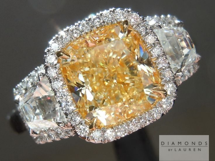 The center diamond on this ring certainly looks like an intense yellow and the entire ring has a presence that will keep your eyes fixated.