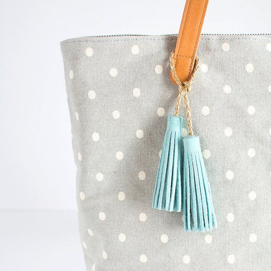 Only takes a few minutes to make these suede tassels to accessorize your bag for a cute and simple back-to-school DIY!
