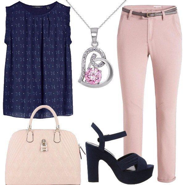 Una blusa blu con dei simpatici cagnolini bianchi, abbinata a pantaloni chino rosa chiaro. Ai piedi dei sandali blu con tacco alto e largo. La borsa a mano è firmata Guess, bella e capiente adatta sia all'ufficio che ha un' uscita con le amiche. Unico bijoux una catenina con un ciondolo a forma di cuore strass e un cristallo rosa.