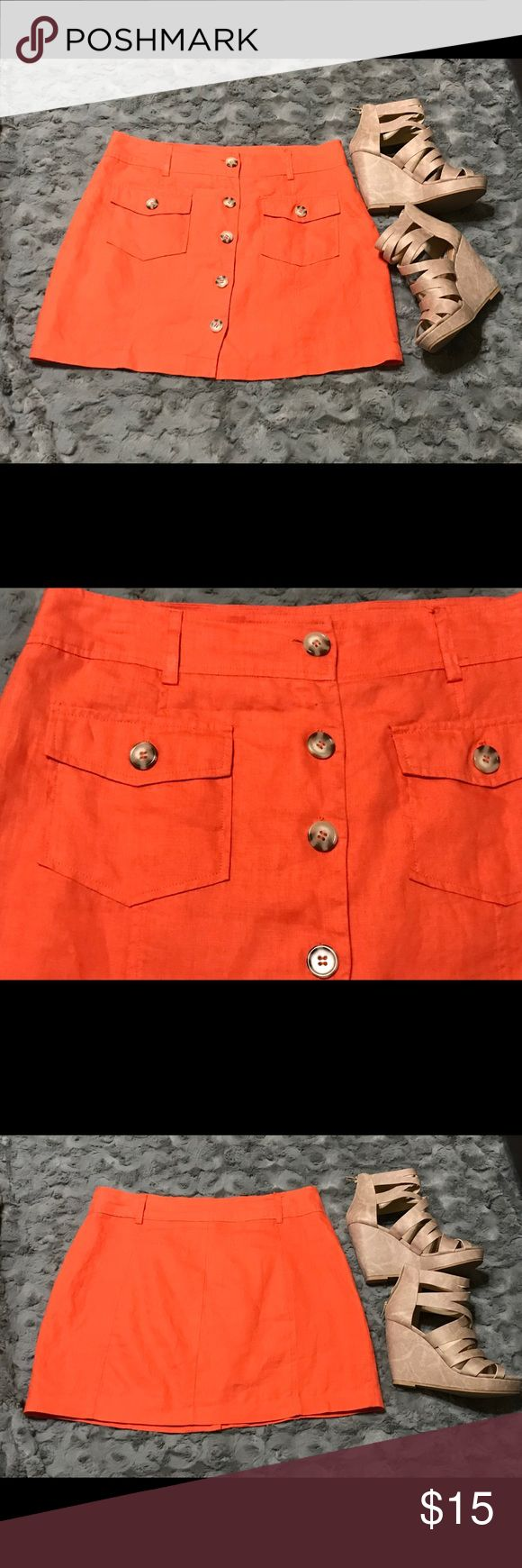 """Love Tree linen mini skirt size large Super cute orange linen A-line above the knee skirt by Love Tree. Size: Large Fully lined, center front button closure with two front button pocket detailing which are functional. Shell is 100% Linen.    Lining is 100% Acetate  Waist measured one side is 16"""" x's 2= 32"""" Length measured center top to bottom = 16.5"""" Hand wash Like new preowned condition. Love Tree Skirts Mini"""