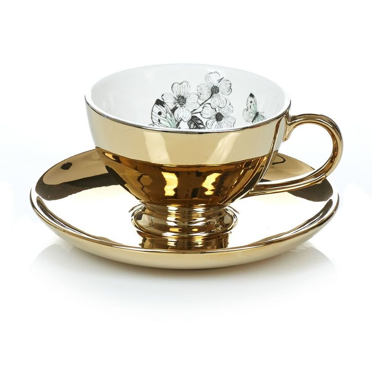 Flüssiges Gold in Form von feinsten Oolong. Passend serviert in dieser goldfarbenen Teetasse. Innen Blumen- und Schmetterlingsmuster.