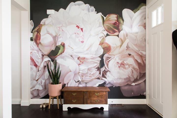 huge, darkly dramatic floral wallpapers that draw you in with their lusciousness and sheer scale.