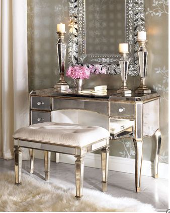Master Bedroom Beauty: Regal and sophisticated, Claludia Mirrored Vanity ($699) and Vanity Seat ($349) will look stunning in an elegantly styled master bedroom. Store your makeup in the side drawers, and adorn the vanity with mirrored pillar candle holders, a silver vase, and an antique hand mirror and brush set.
