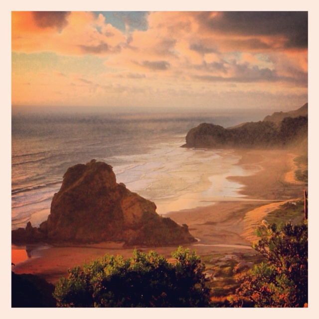 Piha beach at sunset.