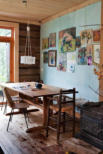 rustic dining room with floral art wall