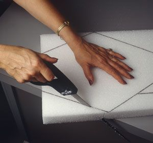 Tips for Cutting Styrofoam brand foam with a knife: wax the blade, use elctric knife, cut with dental floss, etc
