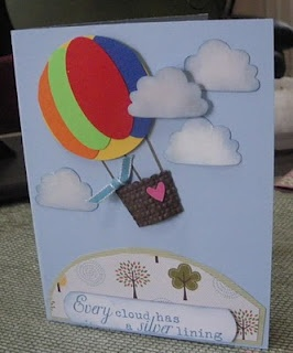 Create a hot air balloon using a cupcake liner die or punch (this one is from Stampin' Up as the basket, and circle punch (balloon base) + oval punches for the balloon. Clouds made with the 'frosting' of the cupcake from Stampin Up punch.