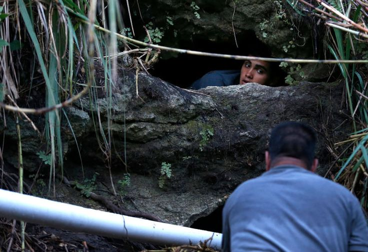 Directing water from a cave spring to drinking water containers in Corozal, Puerto Rico, in October 2017.